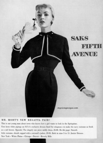 Saks Fifth Avenue Ad 1955 featuring model in sheath dress and gloves for Mr. Mort