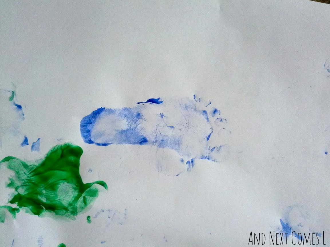 Close up of footprint from stomp painted art from And Next Comes L