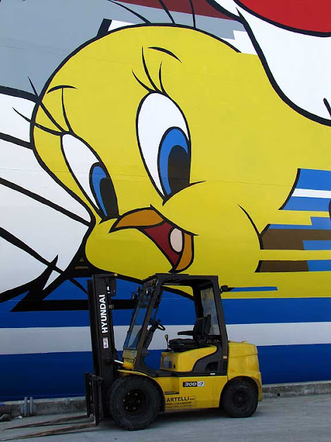 Tweety and a forklift under the Moby Freedom, Livorno