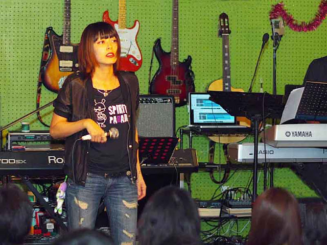 Aki performing on stage