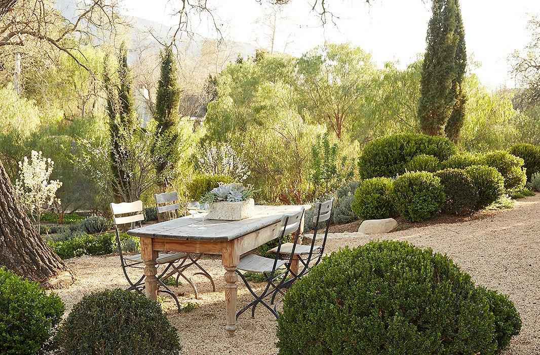 Outdoor dining area in modern farmhouse neutral European antique style Patina Farm Giannetti Home