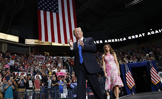 Trump takes victory lap on health care vote, tangles with protesters and jokes about being on Mount Rushmore at Ohio rally with support from Melania and pregnant daughter-in-law Lara