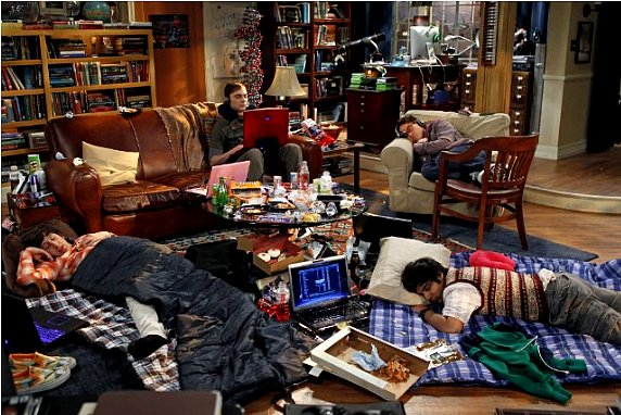 he Big Bang Theory  - Howard and Raj sleep on floor in sleeping bags, Leonard sleeps on his chair, Sheldon awake on the sofa types on his laptop