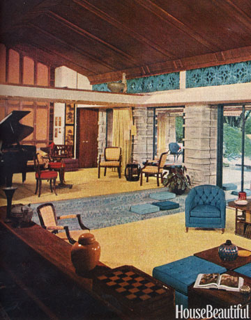 This 60s style living room with pops of blue and yellow is vintage looking.