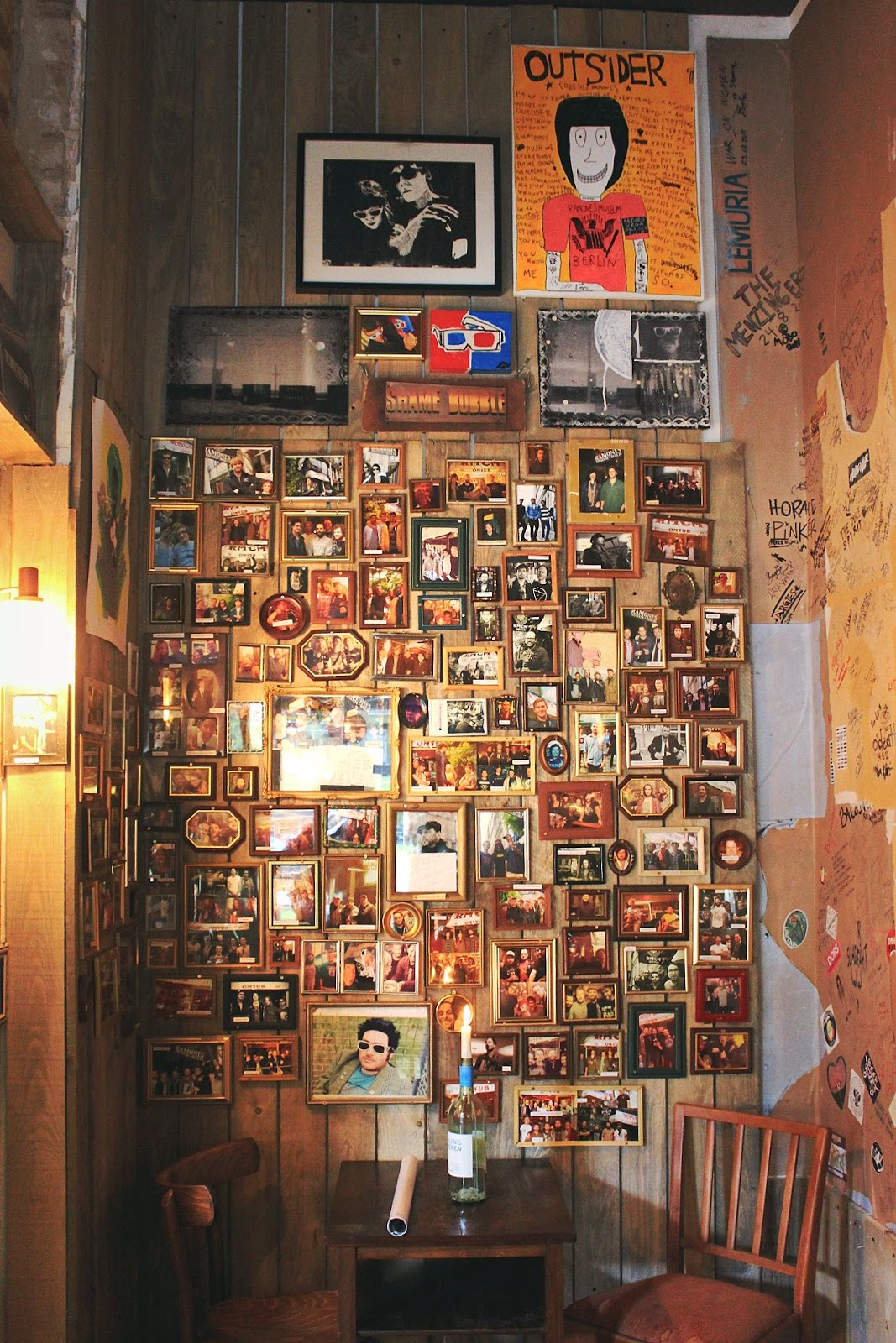 A huge collection of framed photos fill a feature wall in the cafe