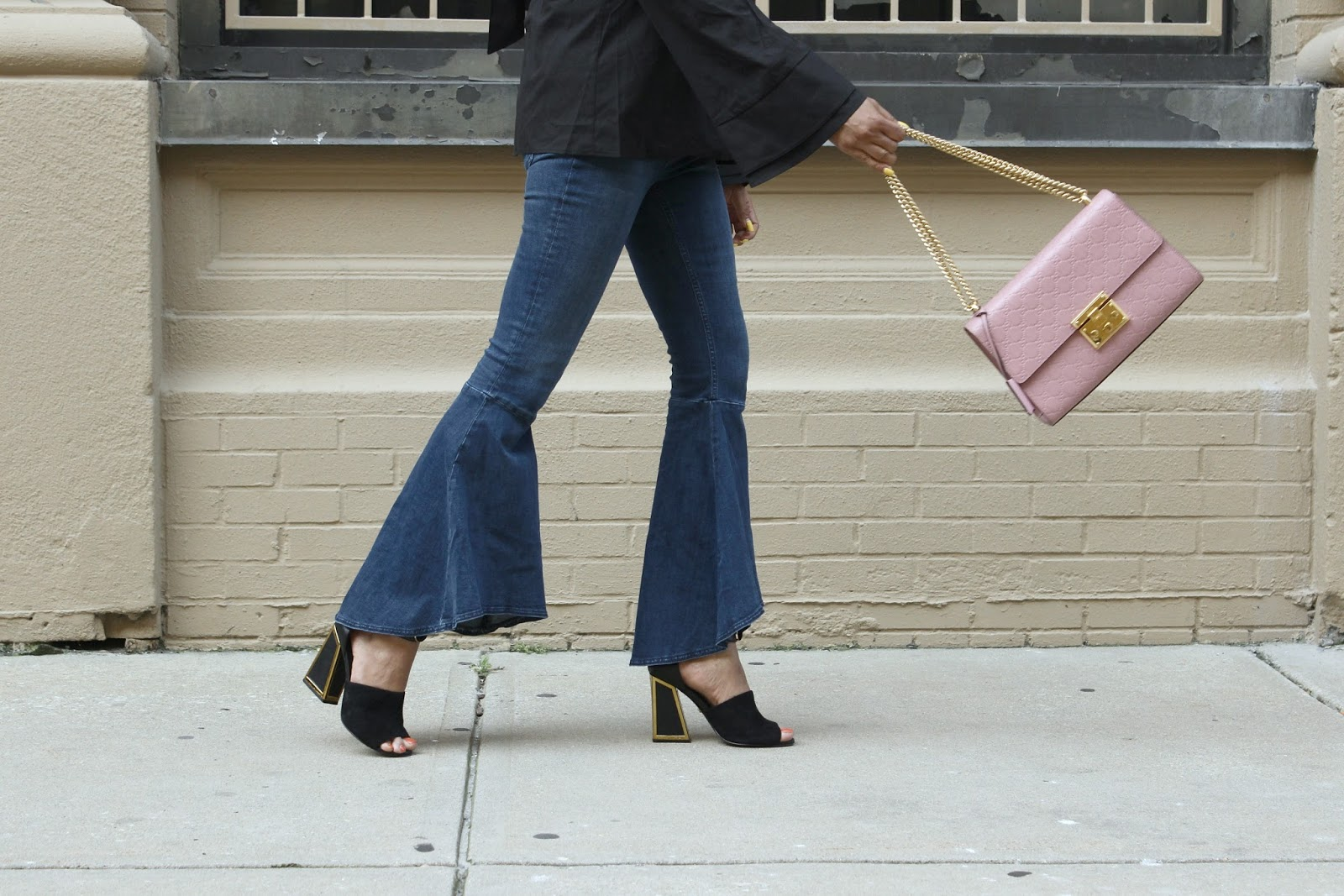 how to wear the 70's trend, bell bottom legs, jeans , wide leg jeans, flared ruffle hem jeans, bow back blouse, black blouse, street style, fashion week style, atlantic city, myriad musings