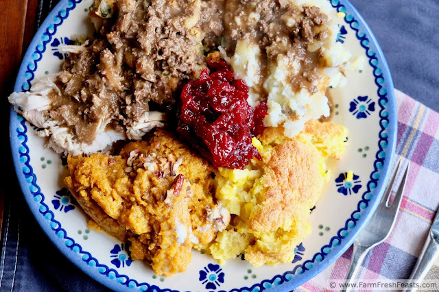 a plate of Thanksgiving foods, including lightened up sweet potato casserole
