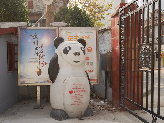 large clothes recycling bin in the shape of a panda in Shanghai