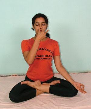 Acharya Pratishtha demonstrates Nadi Shodhan Pranayama yoga posture