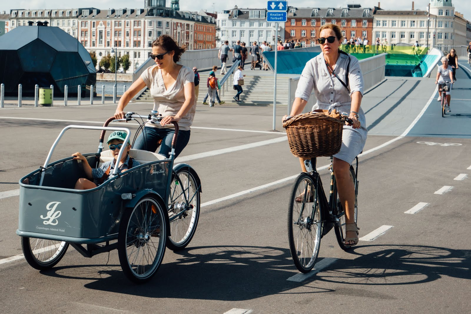 And one from early october in copenhagen the sun was shining and this beautifully colored cargo bike amazed us with the truly happy kido inside