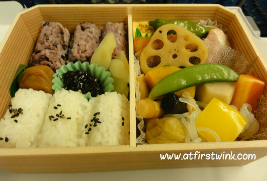 Taste Expo of Japan train bento with rice balls and vegetables