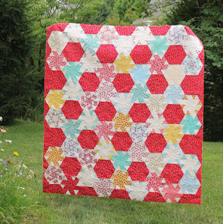 http://bryanhousequilts.com/2016/07/little-ruby-quilt-along-finish.html