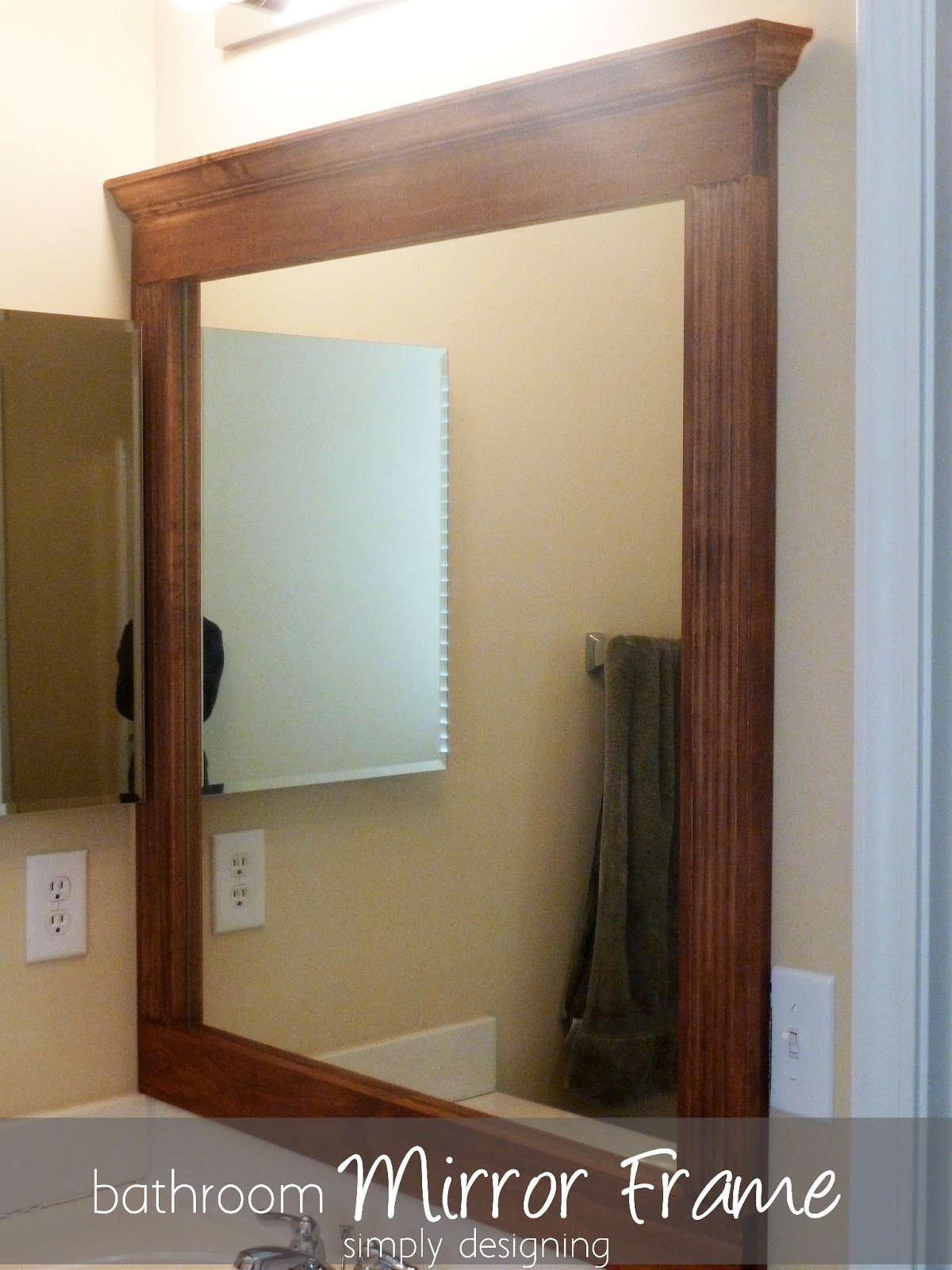 Frame a bathroom mirror with molding -  The Tape In Between The Mirror Frame And The Wall And It Worked Perfectly The Frame Is Perfectly Flush To The Wall And Totally Upgrades Our Bathroom