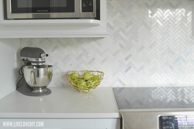 kitchen makeover herringbone marble tile