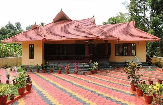 KERALA TRADITIONAL SLOPED ROOF HOME DESIGN