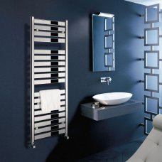 stylish modern heated towekl rail with a wall hung unit and sit on basin and mirror in a bathroom with black tiles