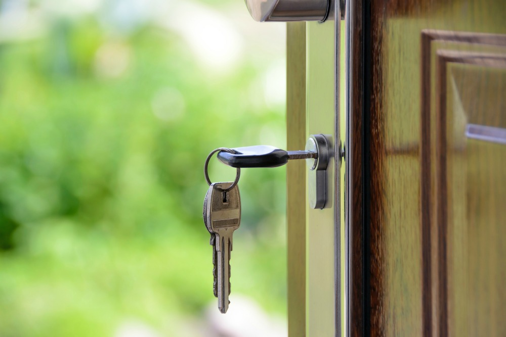 owning your own home with house key