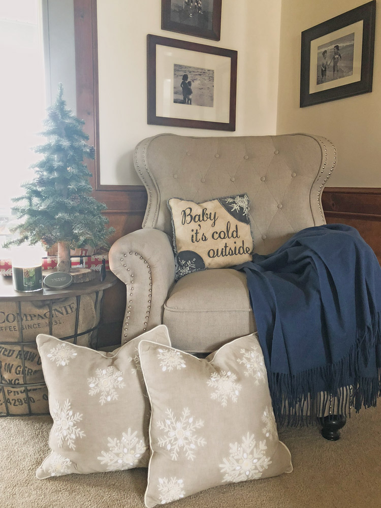 tufted chair with pillows and a throw