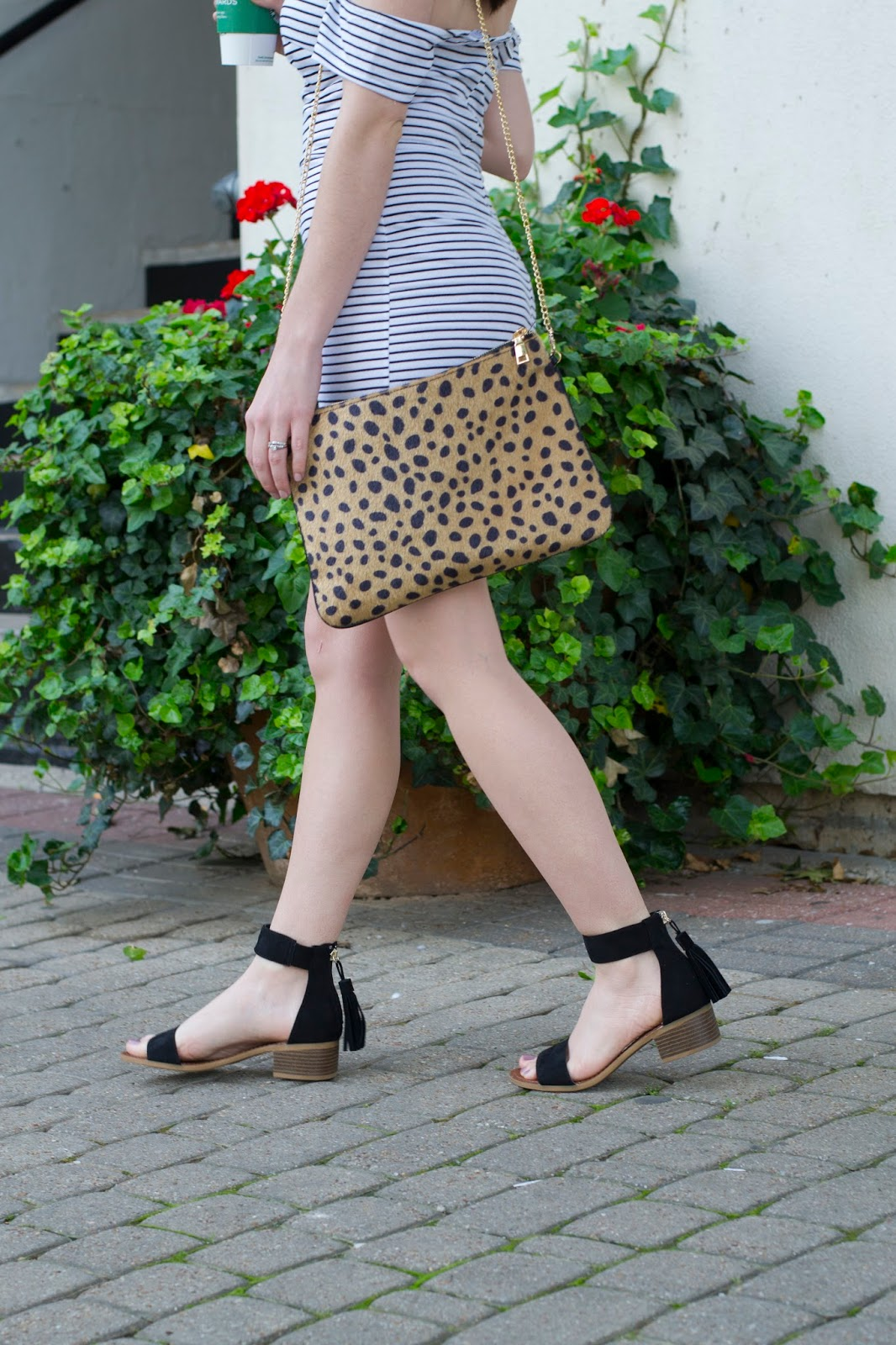Mixing patterns with a striped dress and leopard bag