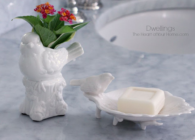 Bird vase and dish make a great pair in the guest bath.