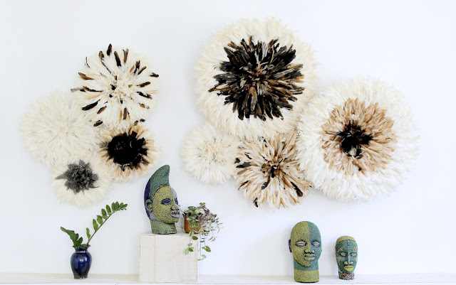 Natural colored juju hats and Ife inspired bead heads. By Kronbali for Ritual Interiors.