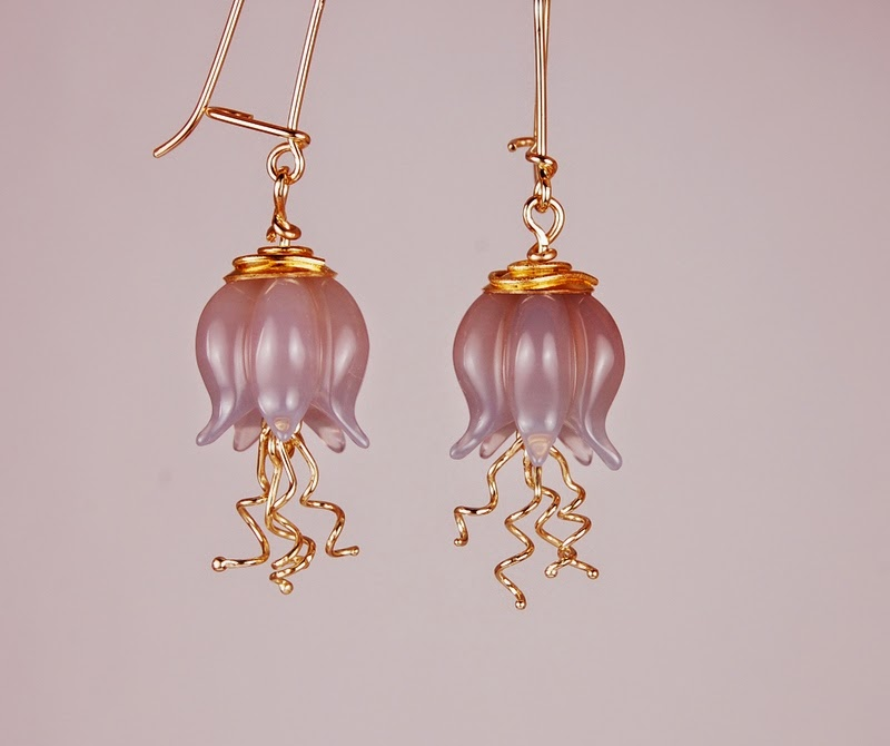 grey carved stones with yellow gold caps and 18k dangles in the shape of a jellyfish