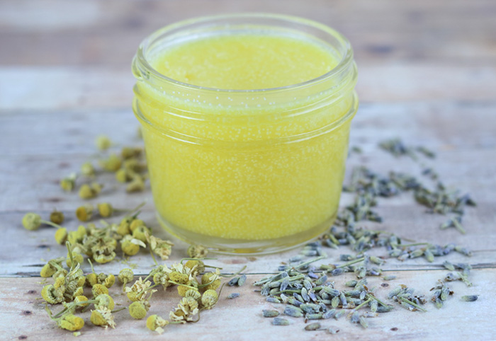 How to make diy after sun balm with calendula and lavender. Use this natural herbal remedies like you would a lotion for sunburn relief.  This homemade salve for skin has coconut oil, shea butter, and aloe vera for skin.  This ater sun salve is a must for summer!  #diy #skincare #herbal #lavender #calendula