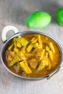 Hagalkai Mavinkai Gojju Bittergourd Raw Mango Curry Karela Kacche Aam sabzi vegan gravy stew bittermelon indian