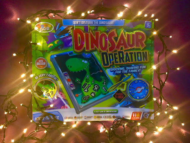 A Dinosaur Operation game surrounded by fairy lights