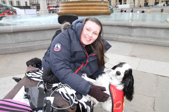 Lucy in Trafalgar Square with her assistance dog Molly