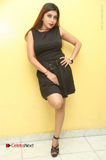 Tollywood Upcoming Actress Pooja Roshan Stills in Black Short Dress at Plus 1 Movie Trailer Launch  0204.JPG