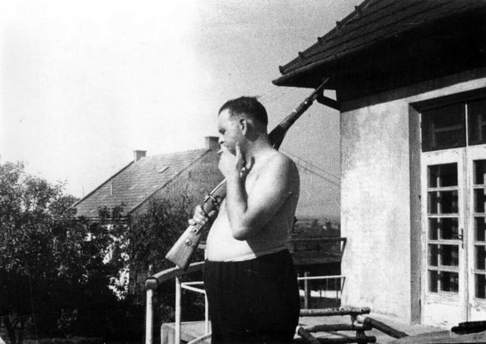 Amon Leopold Goeth was camp commander of the Plaszow concentration camp from February 1943 until September 1944. In the photograph he can be seen standing on his balcony preparing to shoot prisoners.