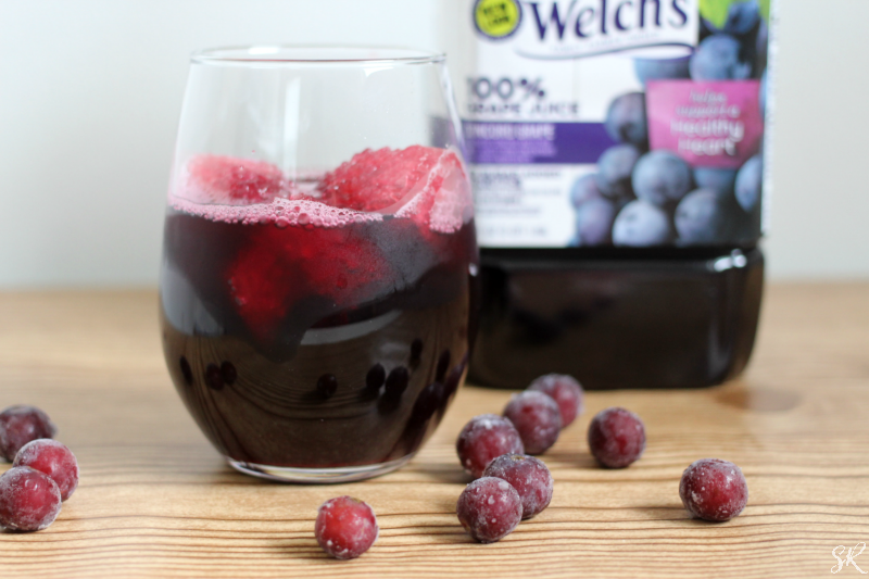 a picture of a bottle and glass of Welch's grape juice