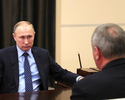 Vladimir Putin and Dmitry Rogozin meeting at Kremlin.