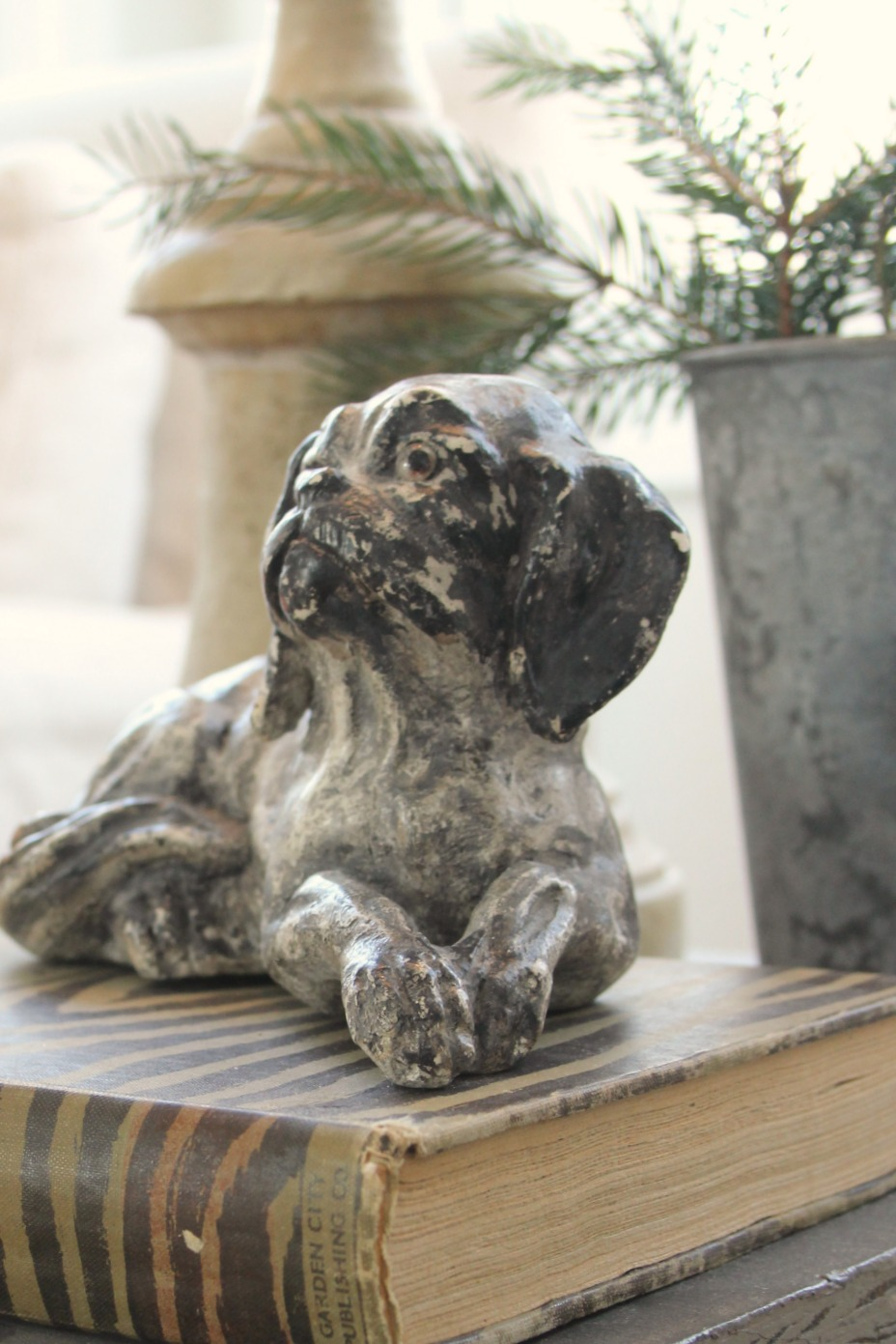 Dog chalkware on book with animal print - Hello Lovely Studio. Come be calmed by How to Freak Less About Holidays, Decorating and Gifts as well as Entertaining.