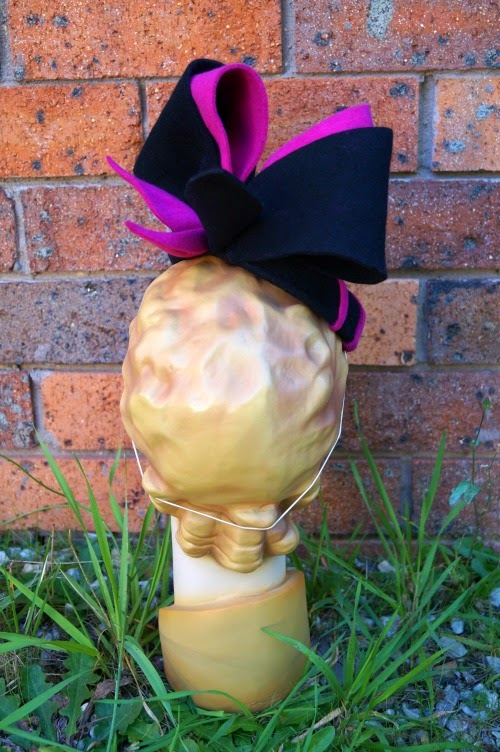Black and pink pillbox fascinator for the races
