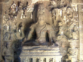 Shiva seated on a throne in a yogic posture, surrounded by gods riding their animal mounts. Ellora, 7th century AD.