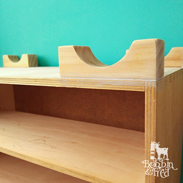 Glue wood toy arch blocks to bottom of desktop moppe drawers to make feet and caulk the gap