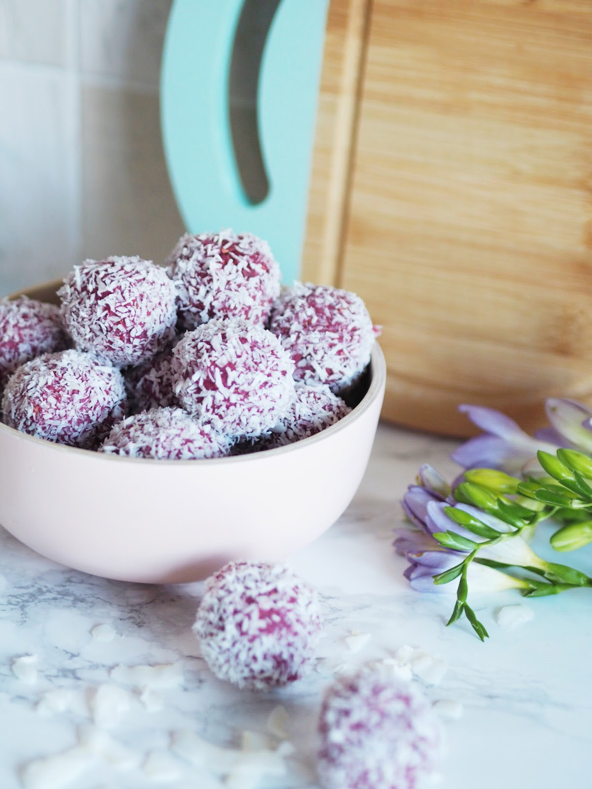 Raspberry & Coconut Protein Energy Balls in Pink Bamboo Bowl