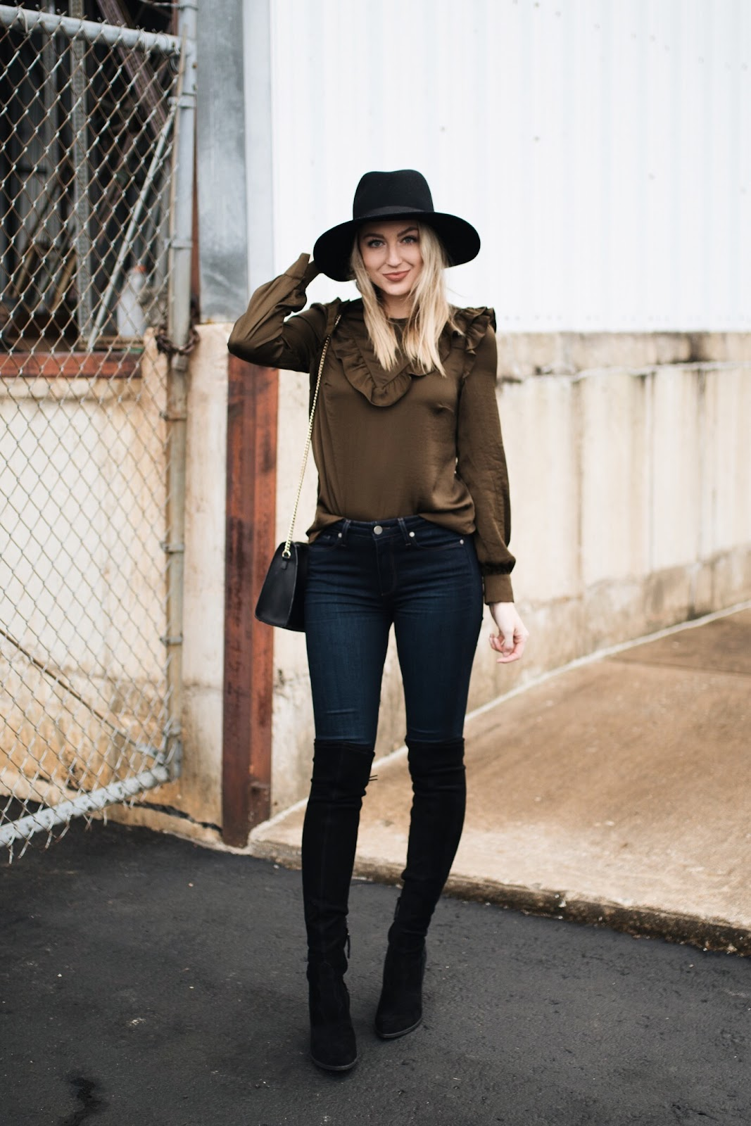 dressy ruffled top dressed down with jeans and boots