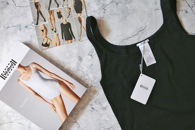 Birds eye view of the Wolford Jamaika String Body on a marble background