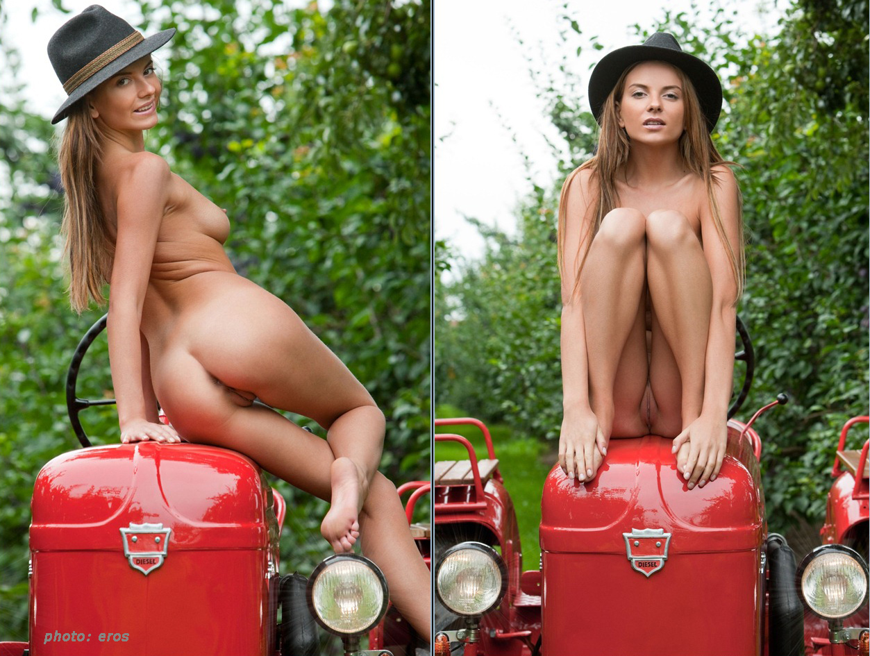 Naked girl on tractor