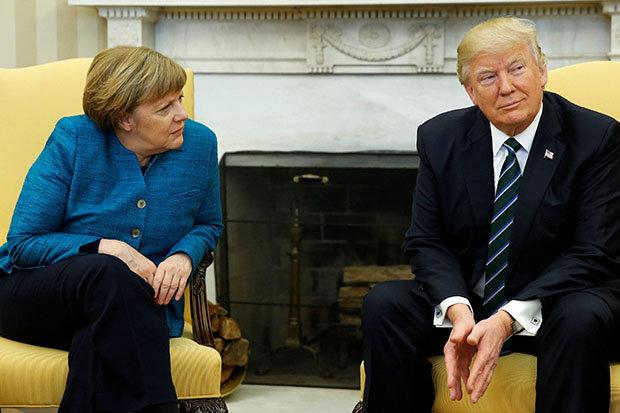 Trump refuses to shake Angela Merkel's hand at white house