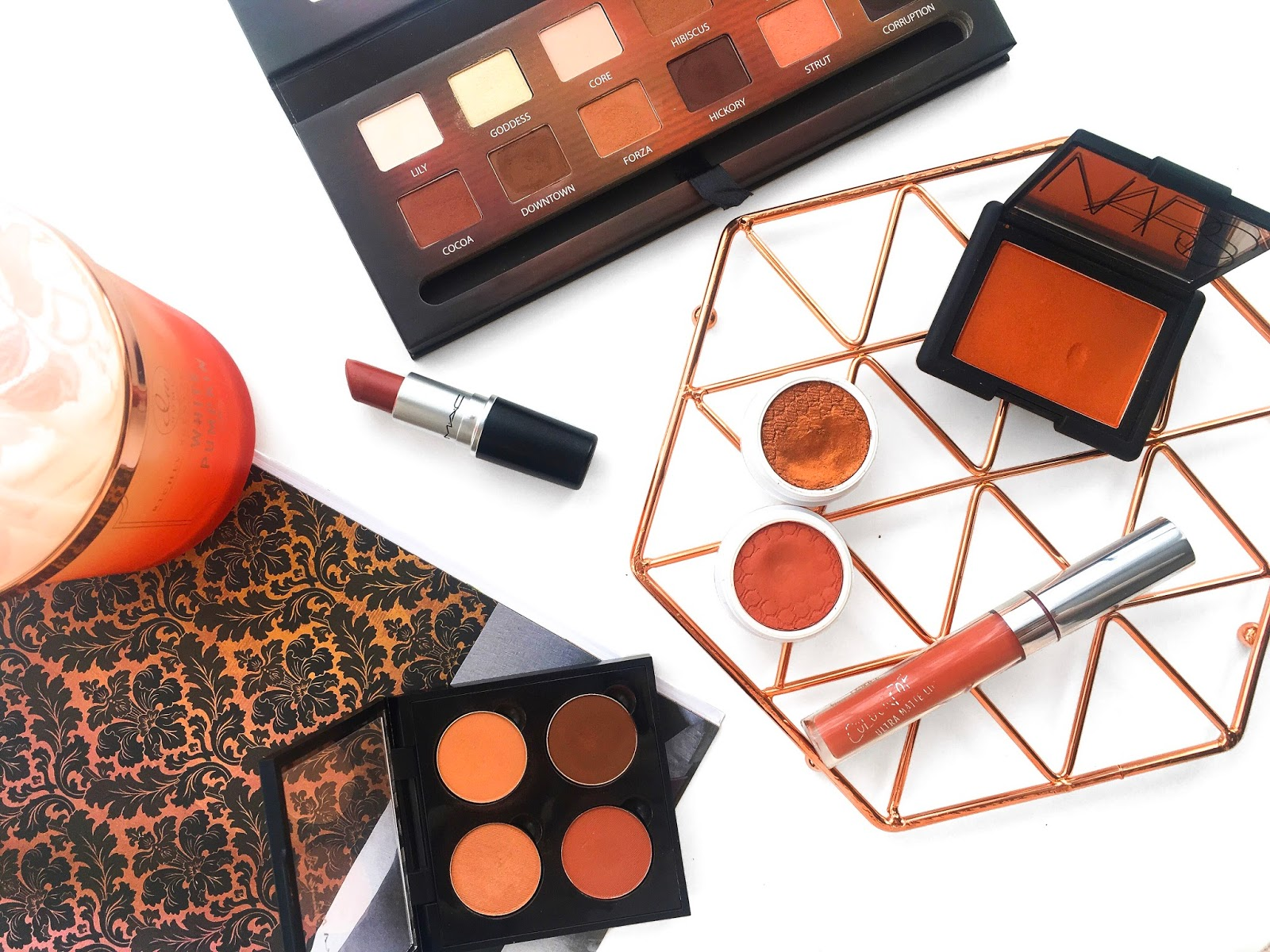 best products for burnt orange makeup looks, burnt orange makeup products, best burnt orange makeup, fall autumn makeup looks, makeup menu, makeup flatlay