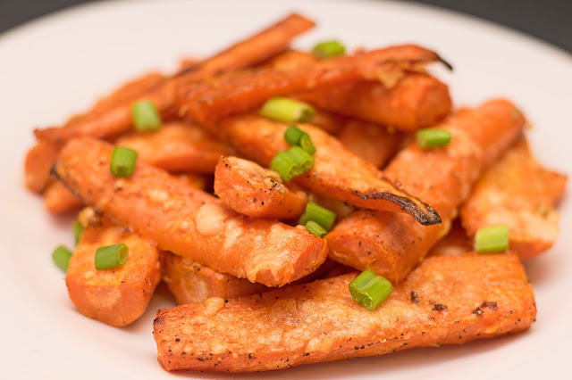 The finished Roasted Parmesan Carrots on a white plate.
