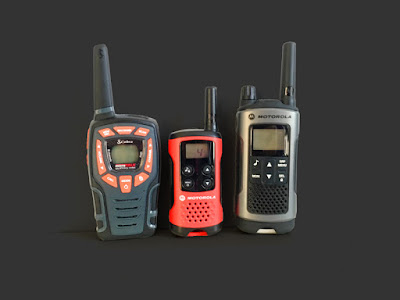 [Image: Photo of three different walkie-talkies.]