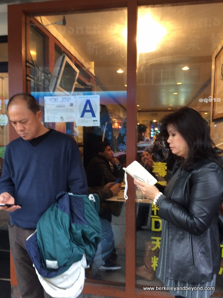 wait outside Buddha Bodai One Kosher Vegetarian Restaurant in NYC