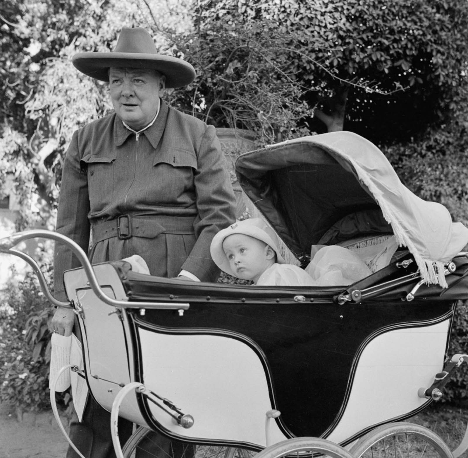 Winston Churchill with baby Victor Lampson. Churchill is wearing an all-in-one