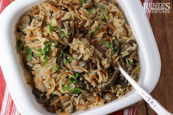 Overhead view of Easy Mushroom Rice Pilaf by Renee's Kitchen Adventures in white serving bowl with spoon