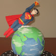Superman flying over the world cake